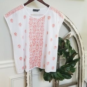 White Top with Coral Embellishments